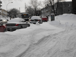 10 days after the snowstorm some Island of Montreal areas have unplowed sidewalks and huge snow piles on their streets.