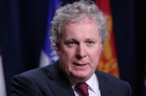Jean Charest resigns amid allegations of corruption and losing his seat in provincial election.