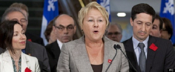 Pauline Marois and company supporting students by wearing red patches